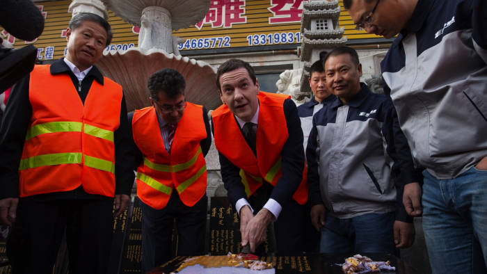 Chancellor of the Exchequer George Osborne visits an industrial area in the city of Urumqi in north west China, after he became the first serving government minister to travel to Xinjiang province. PRESS ASSOCIATION Photo. Picture date: Wednesday September 23, 2015. He met local craftsman and a haulage company, Hualing Industry and Trade Group which today announced it's plan to invest in three property projects in Manchester, Leeds and Sheffield. Mr Osborne is on a five day visit to China which will focus on building trade between the UK and the Chinese. See PA story POLITICS Osborne. Photo credit should read: Stefan Rousseau/PA Wire