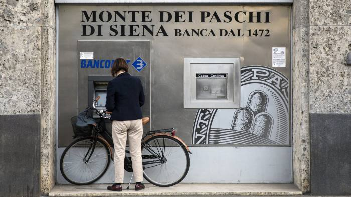 A customer uses a Bancomat automated teller machine (ATM) outside a Banca Monte dei Paschi di Siena SpA bank branch in Milan, Italy, on Tuesday, April 12, 2016. The latest plan to address Italian banks' growing bad debt mountain, and associated solvency concerns, will see the creation of a new fund, Atlante, of about 5 billion euros ($5.7 billion). Photographer: Alessia Pierdomenico/Bloomberg