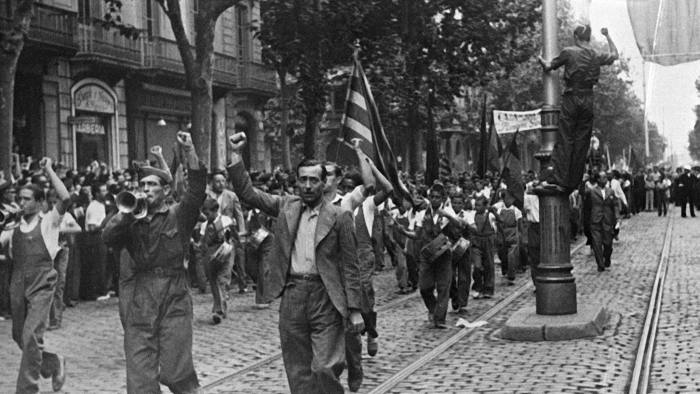 BARCELONA, SPAIN - JULY 1: Picture dated July 1936 showing Republicans of leftist parties demonstrating in the streets of Barcelona against Franco's attempt to overthrow the Spanish Republic. (Photo credit should read STF/AFP/Getty Images)