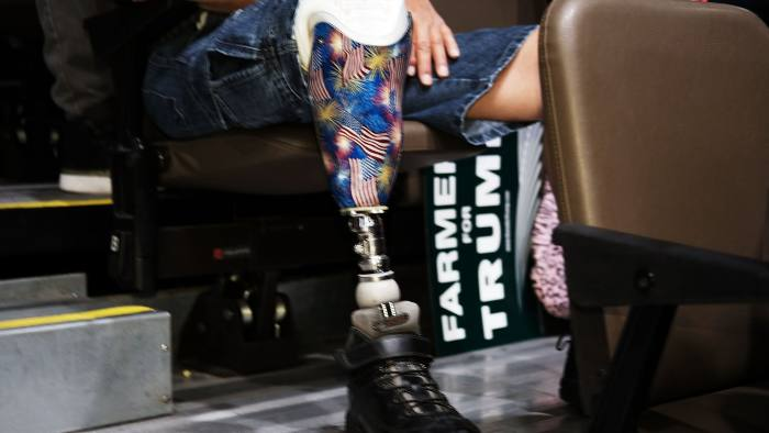 FRESNO, CA - MAY 27: A Donald Trump supporter with a prosthetic leg waits for the presumtive Republican presidential candidate to speak at a rally in Fresno on May 27, 2016 in Fresno, California. Trump is on a Western campaign trip which saw stops in North Dakota and Montana yesterday and two more in California today. (Photo by Spencer Platt/Getty Images)