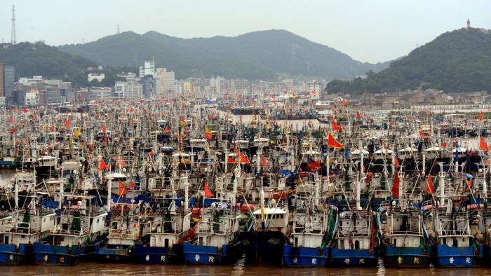 """ZHOUSHAN, CHINA - OCTOBER 12: (CHINA OUT) Fishing boats dock at Shenjiamen Fishing Port to take refuge from the nineteenth typhoon """"Vongfong"""" on October 12, 2014 in Zhoushan, Zhejiang province of China. The nineteenth typhoon """"Vongfong"""" formed at Marshall Islands in north Pacific begins to affect the coastal area of China. (Photo by VCG/VCG via Getty Images)"""