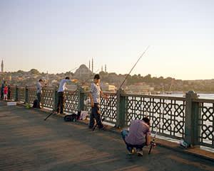 Fishermen on the Galata Bridge spanning the Golden Horn