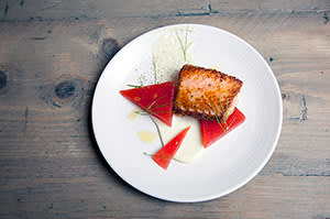 A dish of salmon with watermelon and wasabi by 64 Degrees