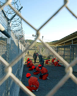 Detainees in a holding area at Guantánamo Bay's Camp X-Ray