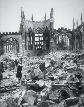 The Coventry Cathedral in ruins after being bombed in 1940