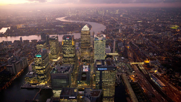 No. 1 Canada Square stands surrounded by the offices of global financial institutions, including HSBC Holdings Plc, Citigroup Inc., JPMorgan Chase & Co., and Barclays Plc, in this aerial photograph looking west along the River Thames towards the City of London from Canary Wharf business and shopping district