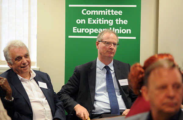 Conservative MP Jeremy Lefroy, right, listens to Boston residents' concerns at the Brexit committee meeting on Thursday