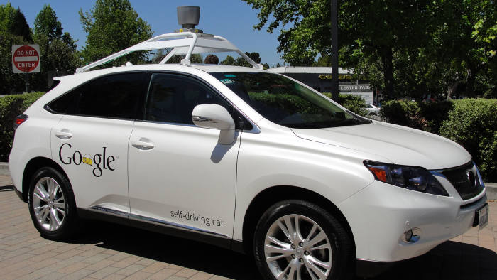 A Google self-driving car is seen in Mountain View, California, on May 13, 2014. A white Lexus cruised along a road near the Google campus, braking for pedestrians and scooting over in its lane to give bicyclists ample space. AFP PHOTO/Glenn CHAPMAN