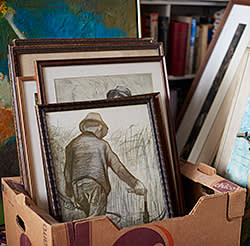 Paintings stacked in the study