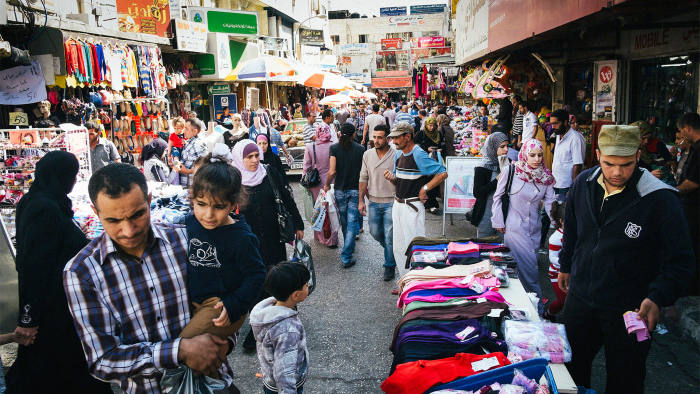 Palestinians shopping through the streets of West Bank city of Ramallah on October 14, 2013, in preparation for the Muslim holiday of Eid al-Adha