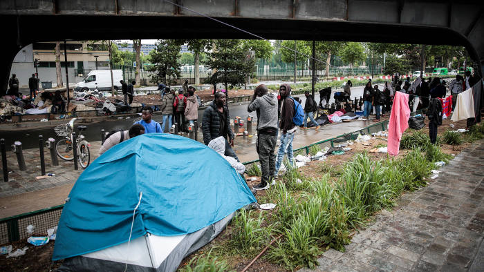 End of the road? A makeshift migrant and refugee camp under a highway near Porte de la Chapelle, Paris