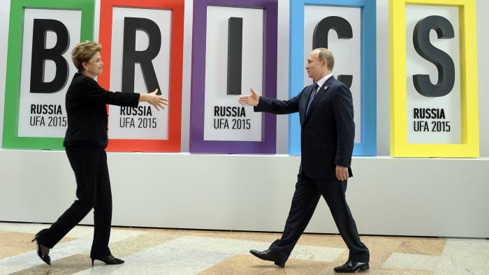 Russia's President Vladimir Putin (R) greets Brazil's President Dilma Rousseff during a welcome ceremony in Ufa on July 9, 2015 at the start of the 7th BRICS summit. Leaders of the BRICS (Brazil, Russia, India, China and South Africa) group of emerging powers gathered in Ufa on Thursday to discuss regional and global issues, including the Syria conflict, threat of the Islamic State group, the situation in Greece and Iran's nuclear programme. AFP PHOTO / ALEXANDER NEMENOV (Photo credit should read ALEXANDER NEMENOV/AFP/Getty Images)