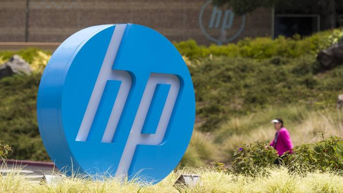 A pedestrian walks near HP Inc. signage at the entrance to the company's headquarters in Palo Alto, California, U.S., on Monday, May 22, 2016. HP Inc. is scheduled to release earnings figures on May 25. Photographer: David Paul Morris/Bloomberg