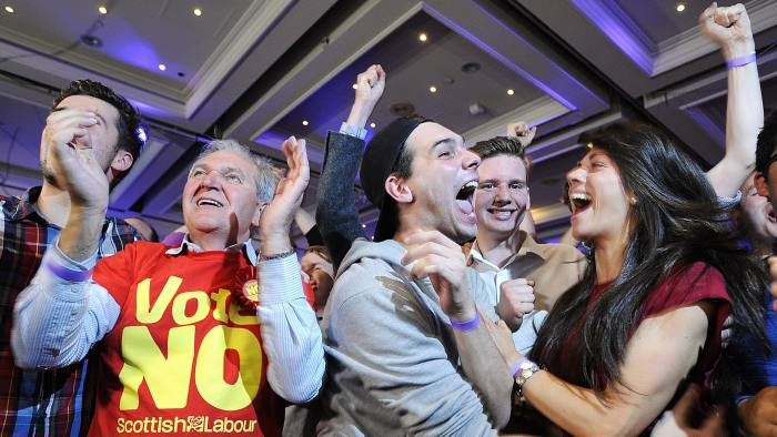 BRITAIN-SCOTLAND-INDEPENDENCE-VOTE...Pro-union supporters celebrate as Scottish independence referendum results are announced at a 'Better Together' event in Glasgow, Scotland, on September 19, 2014. Scotland appeared set to reject independence on Friday with 23 out of 32 voting areas declared and the crucial Glasgow region having given its result. AFP PHOTO / ANDY BUCHANAN (Photo credit should read Andy Buchanan/AFP/Getty Images)