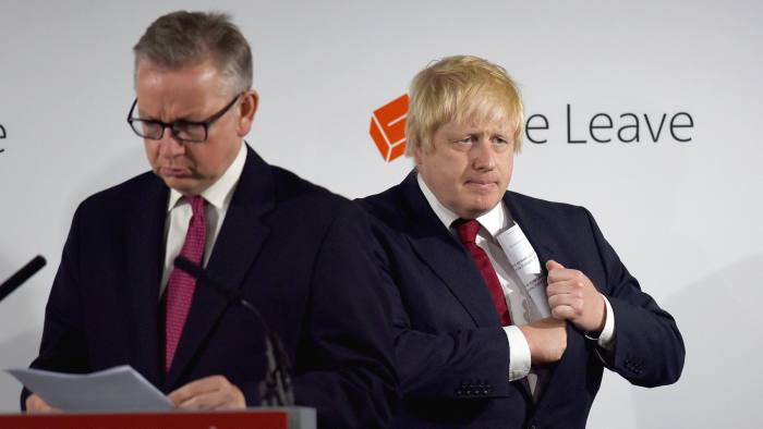 "Michael Gove, U.K. justice secretary, left, prepares to speak as Boris Johnson, former mayor of London, listens during a news conference at the Vote Leave headquarters following the results in the European Union (EU) referendum in London, U.K., on Friday, June 24, 2016. Johnson, the bookmakers' favorite to succeed David Cameron as prime minister after Britain voted to leave the European Union, will have to complete a transition from ""court jester"" to statesman to step into the role. His first task is to articulate what a Brexit will actually mean. Photographer: Mary Turner/Pool via Bloomberg"