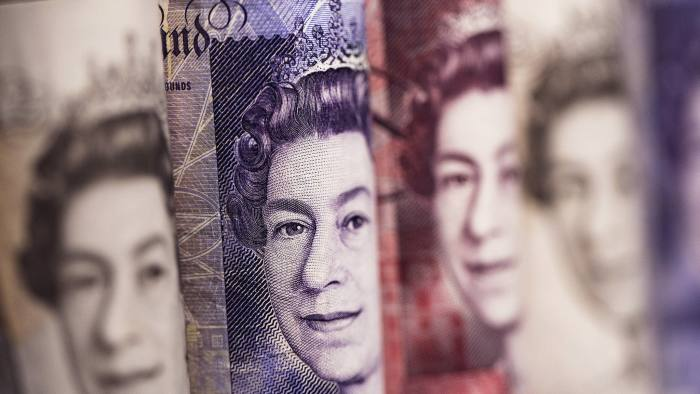 The face of Queen Elizabeth II is seen on rolled ten, twenty, and fifty pound sterling banknotes in this arranged photograph taken in London, U.K., on Thursday, March 6, 2014. The pound was 0.5 percent from the strongest level in four years against the dollar after the Bank of England announced it would keep interest rates at a record low this month. Photographer: Simon Dawson/Bloomberg