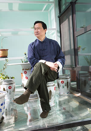 Rao Yi in the sunroom of his home in Beijing