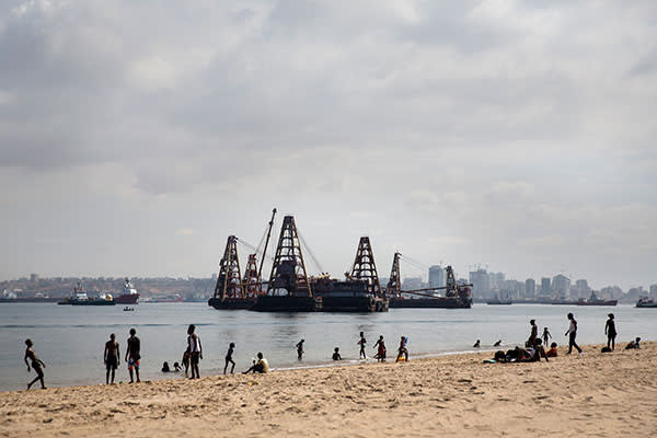 The shoreline in Luanda, Angola's capital, where heavy-lifting cranes serve as reminders of the country's booming oil industry