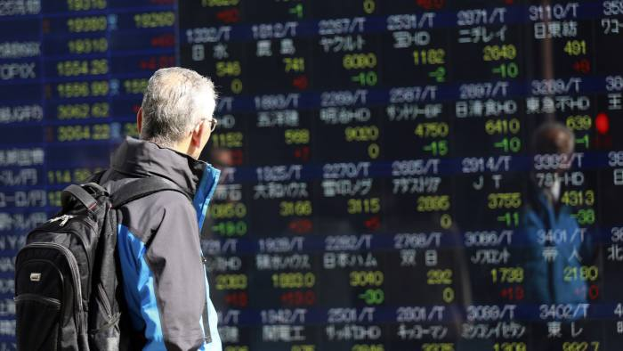 A man looks at an electronic stock board of a securities firm in Tokyo, Thursday, March 9, 2017. Asian stock markets were mostly lower Thursday after news of a big buildup in U.S. oil stockpiles depressed crude prices and shares of energy companies. (AP Photo/Eugene Hoshiko)