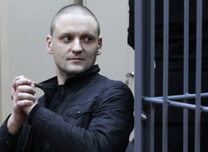 Opposition leader Sergei Udaltsov prepares to listen to the court decision during a hearing in Moscow...Opposition leader Sergei Udaltsov prepares to listen to the court decision during a hearing in Moscow February 9, 2013. Russia's top investigative agency said on Friday it was seeking to put Udaltsov under house arrest charged with plotting mass disorder in protests against President Vladimir Putin. REUTERS/Maxim Shemetov (RUSSIA - Tags: CRIME LAW POLITICS) - RTR3DJFC