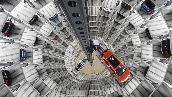 A VW Golf VII car (R) and a VW Passat are loaded in a delivery tower at the plant of German carmaker Volkswagen in Wolfsburg, Germany in this March 3, 2015 file photo. Volkswagen is expected to report Q3 results this week. REUTERS/Fabian Bimmer/FilesGLOBAL BUSINESS WEEK AHEAD PACKAGE - SEARCH