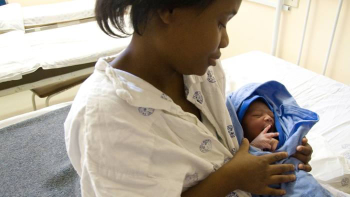 A mother in Durban, South Africa, uses the 'kangaroo care' method