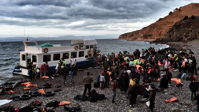 Refugees and migrants arrive at Lesbos island after crossing the Aegean sea from Turkey on October on October 29, 2015. At least seven children died when boats carrying migrants sank off Greece on October 28, as rescue workers battled to save more youngsters on the seashore in the latest desperate scenes in Europe's refugee crisis. Since the start of the year, 560,000 migrants and refugees have arrived in Greece by sea, out of over 700,000 who have reached Europe via the Mediterranean, according to the International Organization for Migration (IOM).AFP PHOTO / ARIS MESSINISARIS MESSINIS/AFP/Getty Images