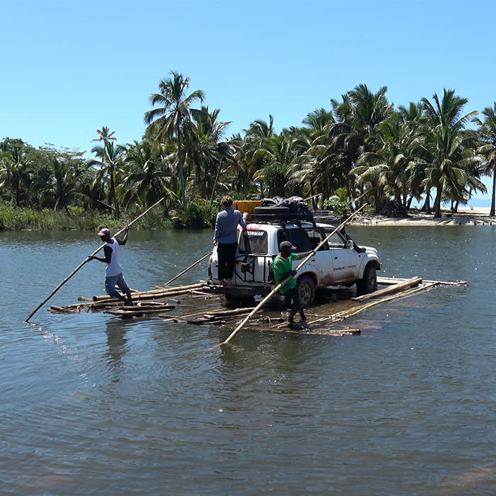 A hand-poled bamboo raft crossing one of the 13 rivers that cut the RN5 along its route