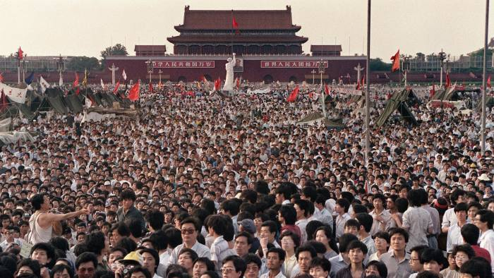 Hundreds of thousands of protesters gather around a replica of the Statue of Liberty, which they called the Goddess of Democracy, in Tiananmen Square, on June 2 1989