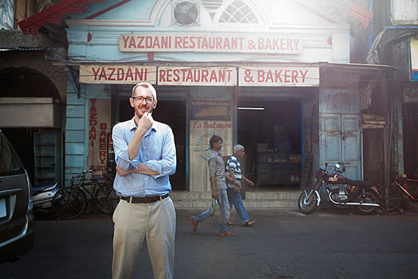 Mumbai, India- 12 March 2016: James Crabtree at the old Yazdani Bakery in Fort area of South Bombay, where he comes often with his son to pick up bun bread.