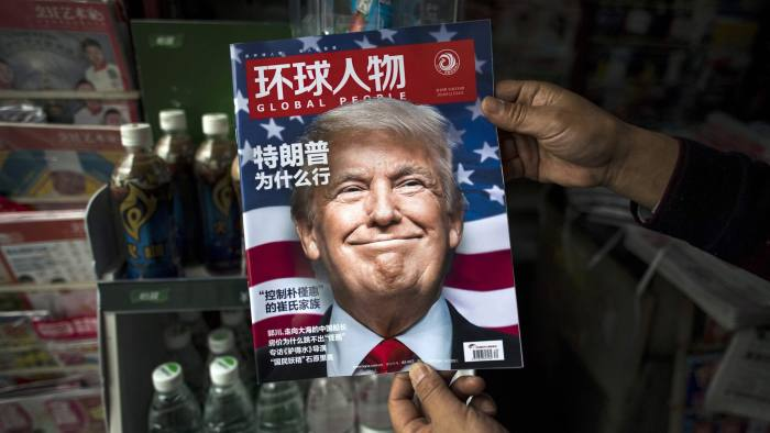 "(FILES) This file photo taken on November 14, 2016 shows a copy of the local Chinese magazine Global People with a cover story that translates to ""Why did Trump win"" at a news stand in Shanghai.  Chinese media warned Donald Trump on December 12 that the one-China policy is ""non-negotiable"" and dropping it could lead to Beijing supporting US enemies, after the president-elect said he might do so unless Beijing made concessions.  / AFP PHOTO / Johannes EISELEJOHANNES EISELE/AFP/Getty Images"