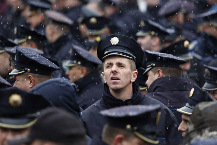 Police officers from across Bosnia's Muslim-Croat Federation take part in protest against a new pension law passed earlier this month, in the Bosnian capital of Sarajevo, Monday, Dec. 18, 2017. Police officers insist the new law will result in significant slashing of their retirement benefits. (AP Photo/Amel Emric)