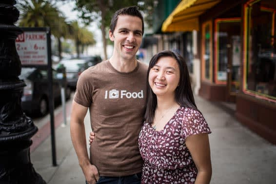 Alexa Andrzejewski and her husband Seth outside the restaurant where they organise an 'eatup'