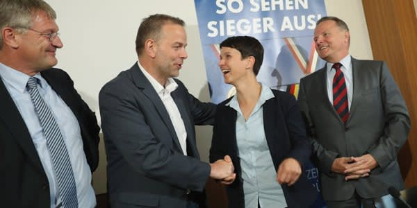 BERLIN, GERMANY - SEPTEMBER 05: Frauke Petry (C), co-head of the Alternative fuer Deutschland (AfD) political party, greets lead AfD candidate in Mecklenburg-Western Pomerania Leif-Erik Holm (C-L) as AfD co-head Joerg Meuthen (L) and Berlin AfD candidate Georg Pazderski look on at a press conference under a banner that reads: