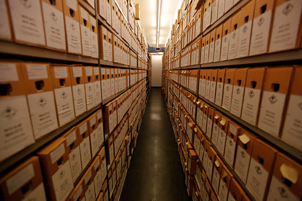 Boxes for evidence are stored in shelves at the International Criminal Court in The Hague