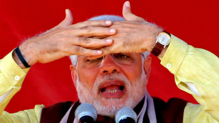 INDIA, DUMKA : Indian Prime Minister Narendra Modi addresses an election campaign rally at Dumka, India's eastern Jharkhand state, on December 15, 2014. Modi campaigned in the eastern Indian state for the ongoing Jharkhand state legislative assembly elections.