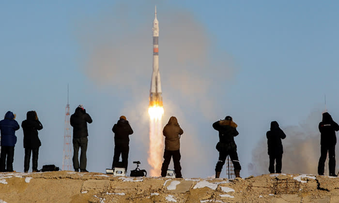 Photographers take pictures as the Soyuz MS-07 spacecraft carrying the crew of Norishige Kanai of Japan, Anton Shkaplerov of Russia and Scott Tingle of the U.S. blasts off to the International Space Station (ISS) from the launchpad at the Baikonur Cosmodrome, Kazakhstan December 17, 2017. REUTERS/Shamil Zhumatov TPX IMAGES OF THE DAY