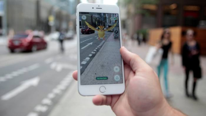 """A """"Pidgey"""" Pokemon is seen on the screen of the Pokemon Go mobile app, Nintendo's new scavenger hunt game which utilizes geo-positioning, in a photo illustration taken in downtown Toronto, Ontario, Canada July 11, 2016. REUTERS/Chris Helgren"""