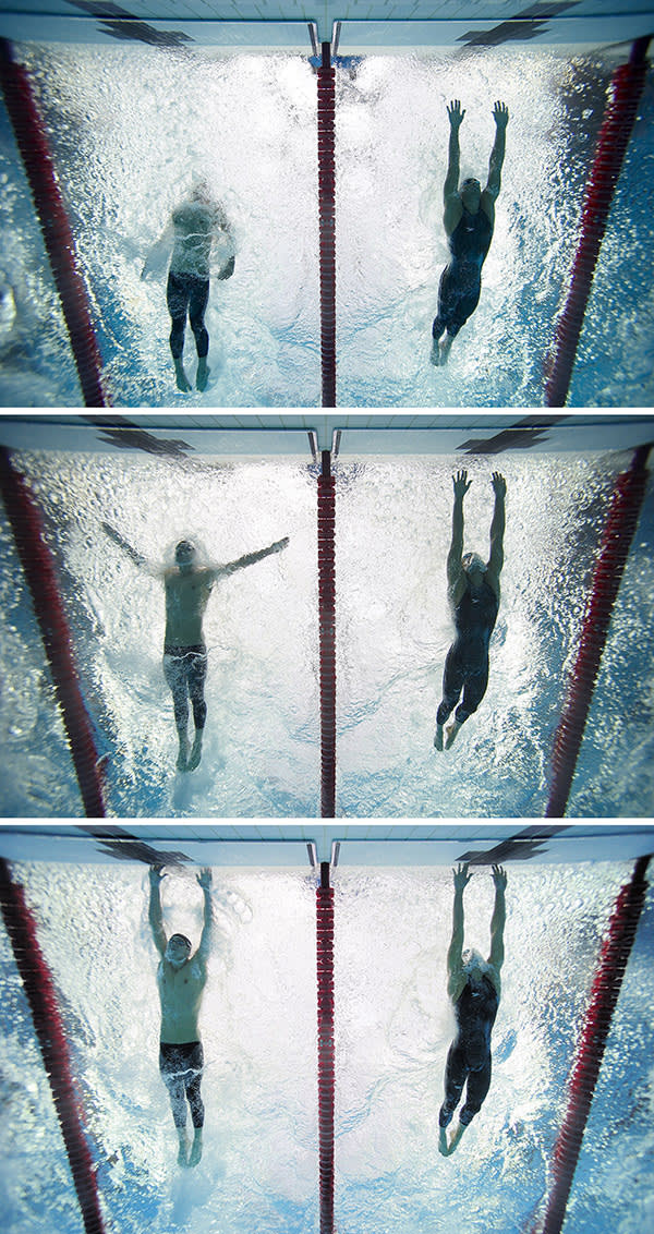Underwater view of USA Michael Phelps (L) and Serbia Milorad Cavic (R) in action, touching wall to finish Men's 100M Butterfly Final at the 2008 Beijing Olympic Games