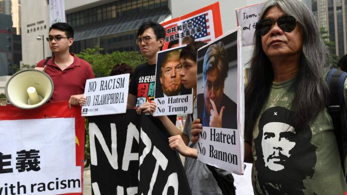 Activists hold a protest in central Hong Kong ahead of Steve Bannon's speech before an investor conference on September 12