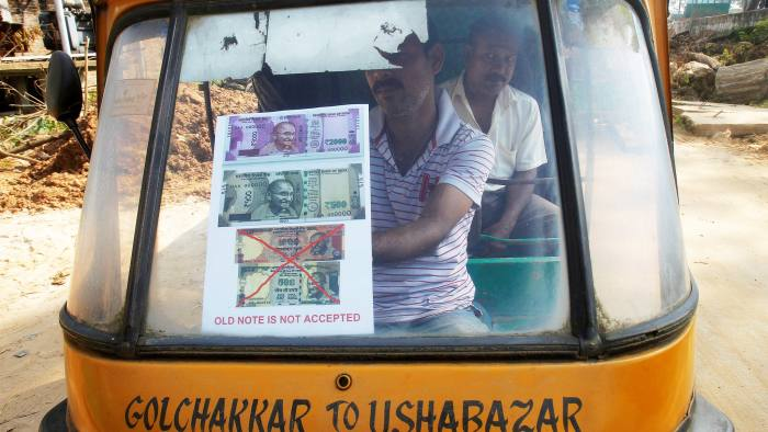 A driver displays a notice on the windscreen of his auto-rickshaw stating the refusal to accept old 500 and 1000 Indian rupee banknotes in Agartala, India, November 14, 2016. REUTERS/Jayanta Dey