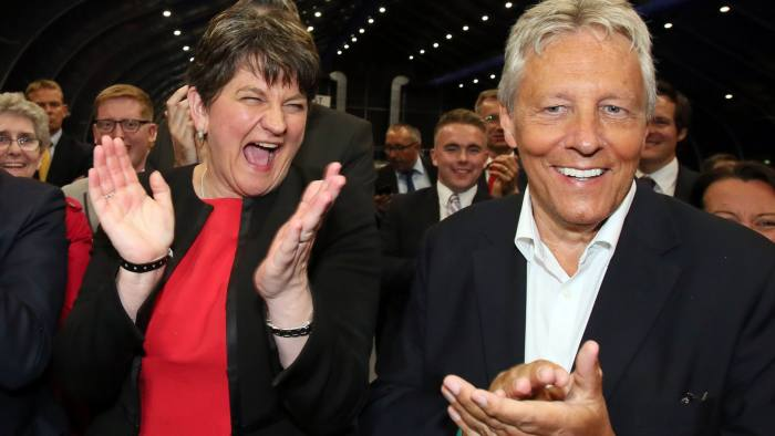 Democratic Unionist Party (DUP) leader Arlene Foster (L) celebrates with Former Democratic Unionist Party (DUP) Leader, Peter Robinson (R) at the counting centre in Belfast, Northern Ireland, early in the morning of June 9, 2017, hours after the polls closed in Britain's general election. Prime Minister Theresa May is poised to win Britain's snap election but lose her parliamentary majority, a shock exit poll suggested on June 8, in what would be a major blow for her leadership as Brexit talks loom. The Conservatives were set to win 314 seats, followed by Labour on 266, the Scottish National Party on 34 and the Liberal Democrats on 14, the poll for the BBC, Sky and ITV showed. / AFP PHOTO / Paul FAITHPAUL FAITH/AFP/Getty Images