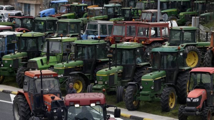 Protesting farmers from the agricultural region of Thessaly arrive with their tractors in Tempe Vale, Greece, Wednesday, Jan. 20, 2016. Convoys of about 800 tractors arrived at the vital point on the main highway traversing Greece from north to south as farmers prepared to block highways to protest unpopular draft pension reforms that will further cut incomes in the austerity-weary country. (AP Photo/Thanassis Stavrakis)