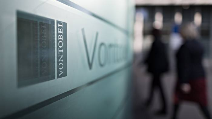 A logo sits on a sign outside the Vontobel Holding AG headquarters in Zurich, Switzerland, on Thursday, March 10, 2016. The Swiss economy returned to growth at the end of last year as it fought off the impact of a currency shock that had threatened to push the country into a recession. Photographer: Michele Limina/Bloomberg