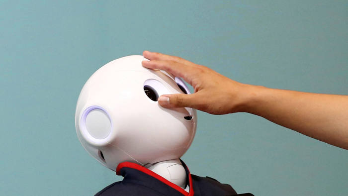 GDNYWM A man touches the head of a SoftBank humanoid robot known as Pepper at the venue for Pepper World 2016 Summer, ahead of its opening on Thursday, in Tokyo, Japan, July 20, 2016. REUTERS/Kim Kyung-Hoon