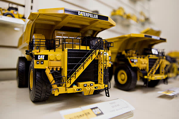 Models of Caterpillar Inc. trucks sit in a display case at the Altorfer Cat dealership in East Peoria, Illinois, U.S., on Tuesday, July 21, 2015