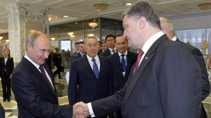 Russian President Vladimir Putin (2nd L) shakes hands with his Ukrainian counterpart Petro Poroshenko, as European Union foreign policy chief Catherine Ashton (L) and Kazakh President Nursultan Nazarbayev (C) stand nearby, in Minsk August 26, 2014. Putin and Poroshenko greeted each other with a handshake at the start of talks in Belarus on Tuesday on the Ukraine crisis, the first time the two presidents have met since June. REUTERS/Sergei Bondarenko/Kazakh Presidential Office/Pool (BELARUS - Tags: POLITICS) - RTR43TY7