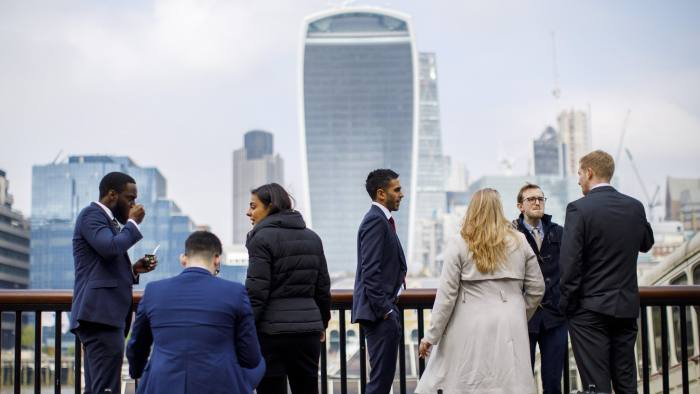 Financial workers enjoy their lunch breaks in the City of London on 16 March 2017. Picture credit: Tolga Akmen