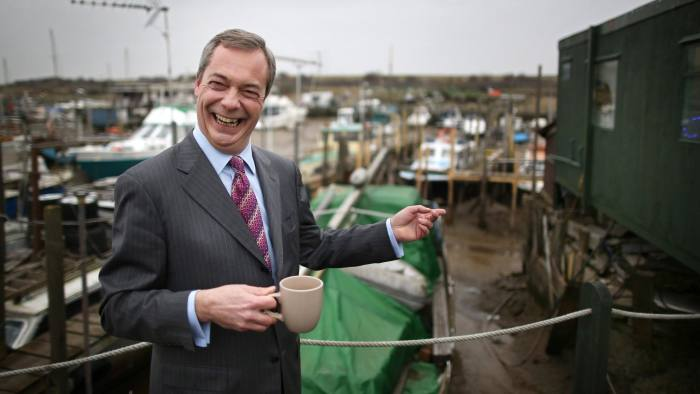 CANVEY ISLAND, ENGLAND - FEBRUARY 12: United Kingdom Indepedence Party (UKIP) leader Nigel Farage drinks a cup of tea outside The Little Green Tearoom at the Smallgains boatyard as he campaigns ahead of the general election on February 12, 2015 in Canvey Island, England. Mr Farage is making his first major speech of the 2015 general election. He has stated that both the Conservative and Labour parties fear that UKIP will hold the balance of power in an election with no clear winner. (Photo by Peter Macdiarmid/Getty Images)