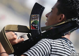 An armed Libyan rebel fighter stands guard